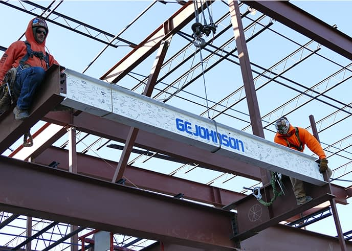 GE Johnson team members installing final beam